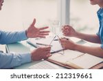 two partners discussing... | Shutterstock . vector #212319661