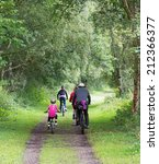 Family Cycling In The Consall...