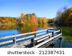 Stock photo board walk near the lake in autumn time 212387431