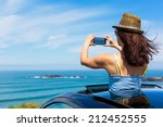 happy woman taking photos to... | Shutterstock . vector #212452555
