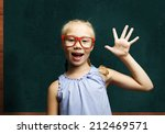 genius girl in red glasses near ... | Shutterstock . vector #212469571