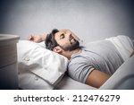 man sleeping in bed | Shutterstock . vector #212476279