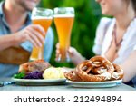 smiling bavarian couple wearing ... | Shutterstock . vector #212494894