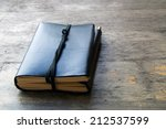 A Leather Bound Journal Sits O...