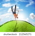a woman doing a cartwheel on... | Shutterstock . vector #212565271