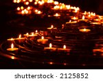Rows Of Burning Candles In A...