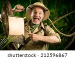Cheerful Explorer Pointing To A ...