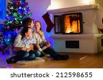 father and kids sitting by a... | Shutterstock . vector #212598655