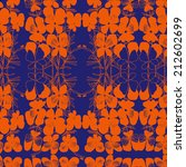 Vector pattern with orange hand drawn flower viola tricolor. Dark blue background.