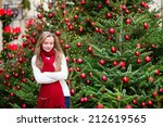 Girl with a brightly decorated Christmas tree - stock photo