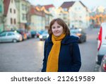 Cheerful girl on a street of Strasbourg during Christmas time - stock photo