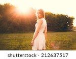 girl in the park in a white... | Shutterstock . vector #212637517