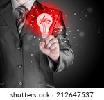 business man touching light of... | Shutterstock . vector #212647537
