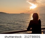 Girl Looks At The Sunset On Th...