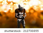football player on a orange... | Shutterstock . vector #212733355