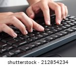 woman typing on keyboard.  | Shutterstock . vector #212854234