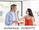 young woman give a strawberry... | Shutterstock . vector #212863771