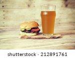 craft beer with hamburger  | Shutterstock . vector #212891761