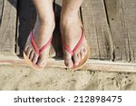 women foots on the beach. pink... | Shutterstock . vector #212898475