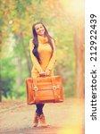 brunette girl holding suitcase... | Shutterstock . vector #212922439