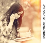 teen girl with notebook in the... | Shutterstock . vector #212922469