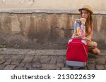 young girl and red suitcase on... | Shutterstock . vector #213022639