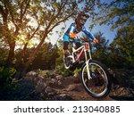 cyclist riding a mountain bike... | Shutterstock . vector #213040885