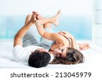 Young Laughing Couple Laying O...