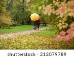 Couple With Umbrella During...