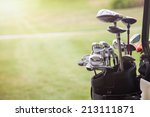 Set Of Golf Clubs Over Green...