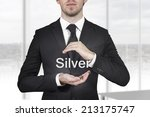 businessman protecting the word ... | Shutterstock . vector #213175747