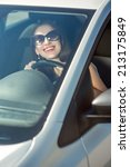 young smiling woman driving her ... | Shutterstock . vector #213175849