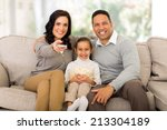 young family watching tv in the ... | Shutterstock . vector #213304189