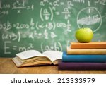 school books with apple on desk ... | Shutterstock . vector #213333979