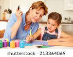 grandmother painting with... | Shutterstock . vector #213364069