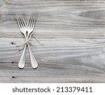 Crossed Vintage Forks On Old...