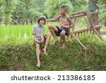 Little Boy And Girl Farmer On...