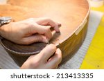 an italian luthier working on... | Shutterstock . vector #213413335