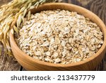 rolled oat flakes in a wooden... | Shutterstock . vector #213437779