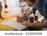 an italian luthier working on... | Shutterstock . vector #213509209