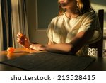 a young woman is sitting at a... | Shutterstock . vector #213528415