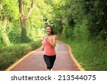 young fitness woman running at... | Shutterstock . vector #213544075