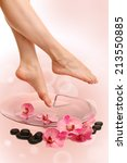 female feet in spa bowl with... | Shutterstock . vector #213550885