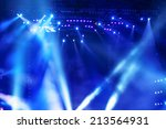 stage spotlight with laser rays | Shutterstock . vector #213564931