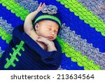 3 week old baby outside in a handmade/crocheted Seattle Seahawks bunting and hat -- image taken in Reno, Nevada, USA