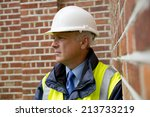 pensive construction worker | Shutterstock . vector #213733219