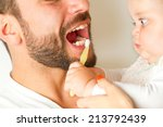 baby cleaning the teeth from... | Shutterstock . vector #213792439