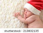 Christmas Baby Wearing A Santa...