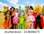 happy excited kids in halloween ... | Shutterstock . vector #213838675