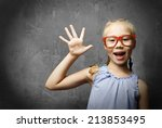 genius girl in red glasses near ... | Shutterstock . vector #213853495